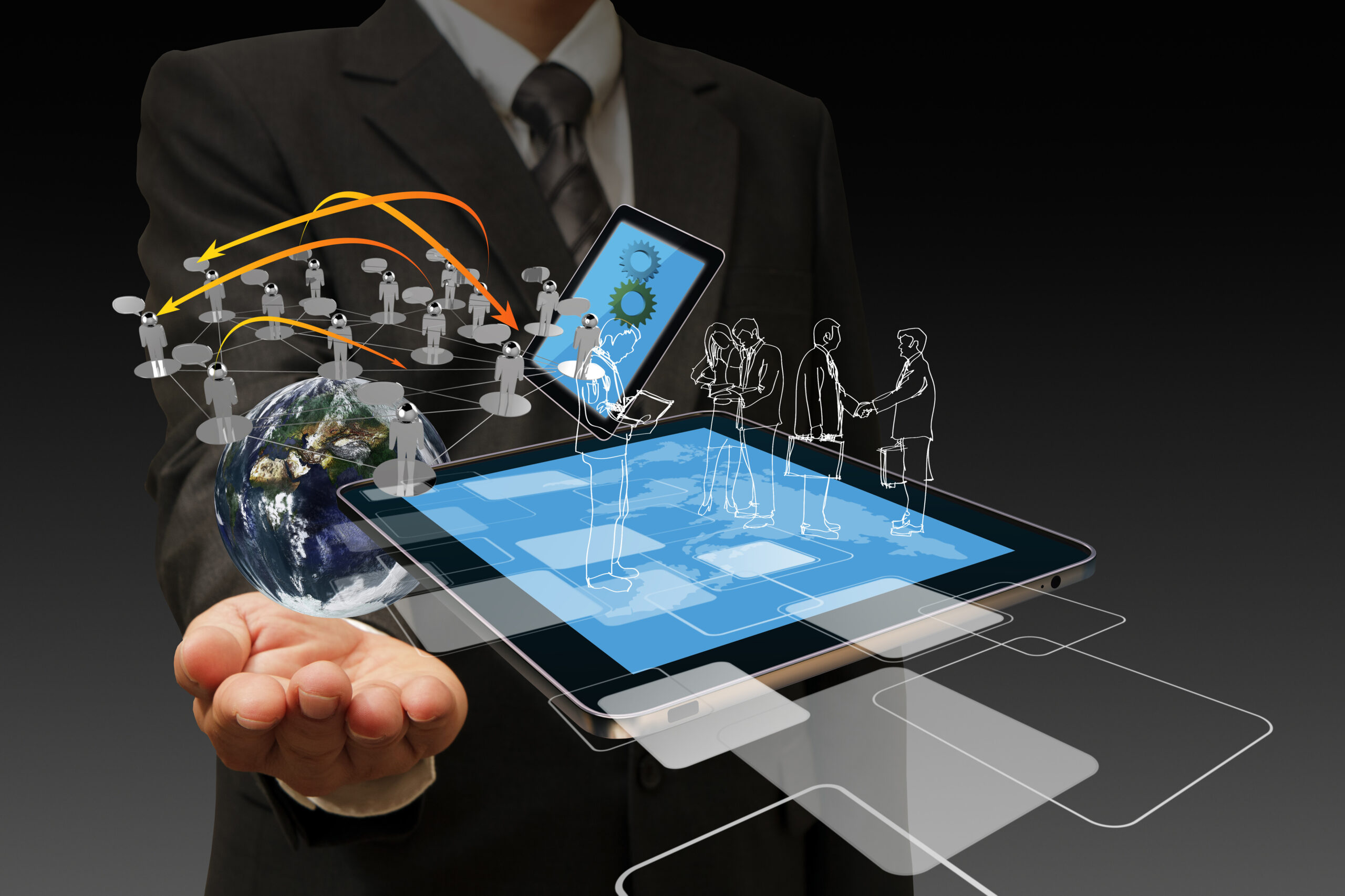 Technology in the hand of businessmen on dark background